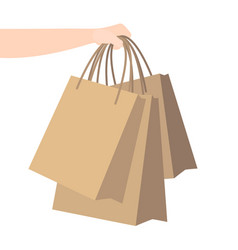 Hand holds kraft paper bags home delivery vector