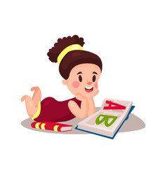 sweet little girl lying on her stomach and reading vector image