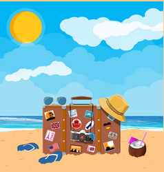leather retro bag with stickers on beach vector image