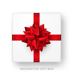 decorative white gift box with red bow and ribbon vector image