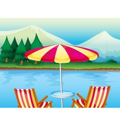 A beach umbrella with chairs vector image vector image