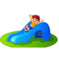 Boy sliding in the park vector