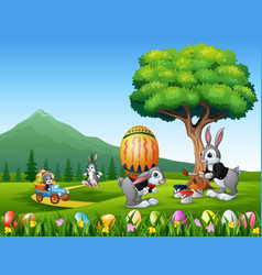 happy easter bunnies painting and holding egg vector image
