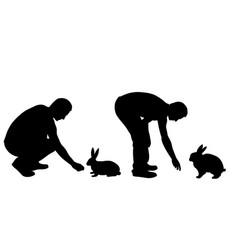 Silhouettes men feeding rabbits vector