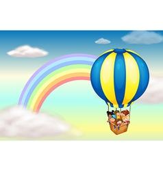 A hot air balloon near the rainbow vector