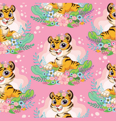 Seamless pattern with cute tigers and flowers vector