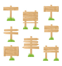 wooden sign standing in green grass vector image vector image