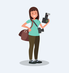 Woman photographer holding a camera vector