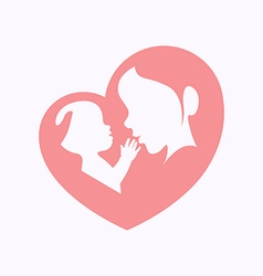 Mother holding a baby in heart shaped silhouette vector
