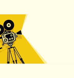 Yellow background with vintage movie camera vector