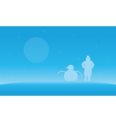 Christmas landscape people and snowman silhouettes vector image vector image