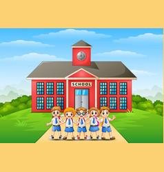 Happy school children in front of school building vector