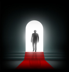 Man goes to the light on the red carpet vector