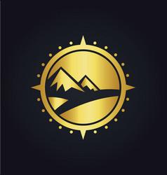 Mountain adventure compass gold logo vector