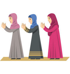Women in traditional muslim clothes pray vector