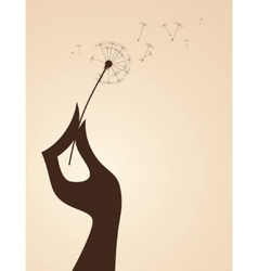Hand with dandelion vector