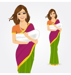 Happy indian mother holding her baby vector