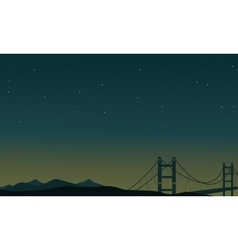 At night bridge scenery of silhouettes vector image