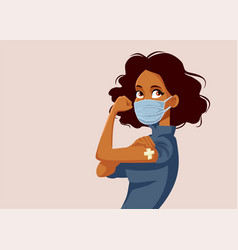 African woman showing vaccinated arm vector