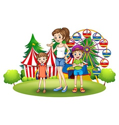 A family at the amusement park with a ferris wheel vector image