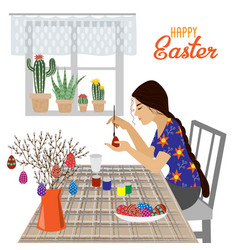 the girl at the table paints easter eggs vector image