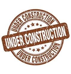 Under construction brown grunge round vintage vector