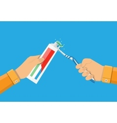 Hands use toothpaste and a toothbrush vector