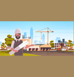 man architect in helmet holding rolled up vector image