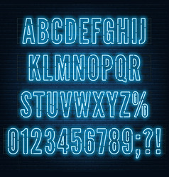 retro blue neon alphabet with numbers on dark vector image