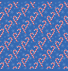 Seamless pattern with candy canes vector