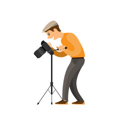Photographer adjusting digital camera on tripod vector