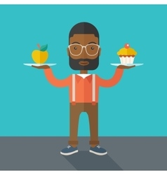 Man carries with his two hands cupcake and apple vector image