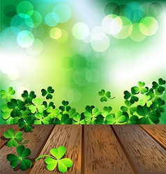 Shamrock on wooden floor for St Patricks Day card vector image