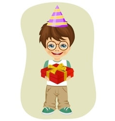 Boy with party hat holding birthday gift vector