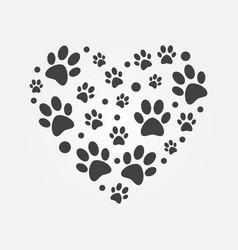 dark paw prints in heart shape vector image