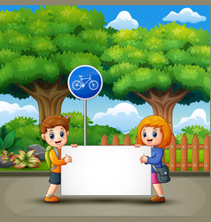 two cute kids are holding a banner in the city par vector image