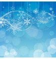 abstract snowflakes on blue bokeh background vector image vector image