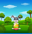 cartoon bunny holding easter eggs in the park vector image vector image