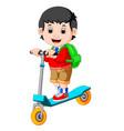 boy playing push bicycle vector image
