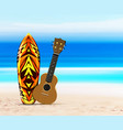 Ukulele guitar and surfboard on beach against