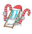 santa with candy beach chair mascot cartoon vector image