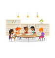 group of children sitting around table at school vector image vector image