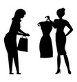 women with clothes on hangers silhouette vector image