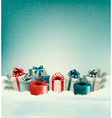 Christmas gift boxes in snow vector image vector image