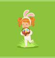 happy little girl with bunny ears and rabbit vector image