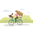 young woman is riding on bicycles with a dog on vector image vector image