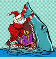 santa claus pushes christmas gift into shark mouth vector image