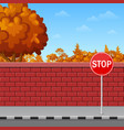 brick wall with stop sign on the pavement vector image vector image