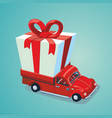 red car with a present delivery service carton vector image vector image