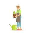 active senior woman planting cactus in a pot